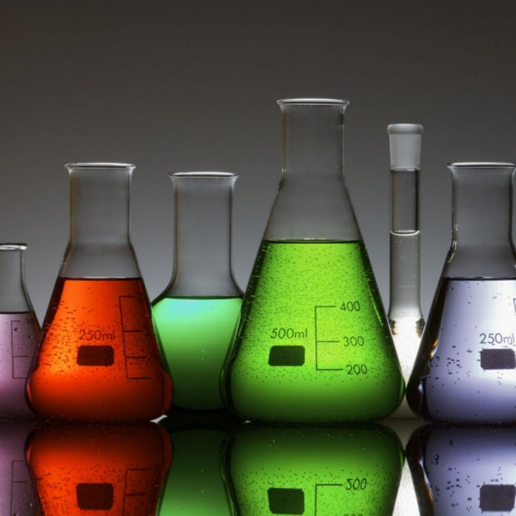 Conical flasks with coloured liquid