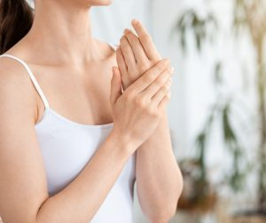 woman moisturising her hands