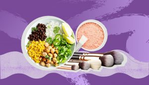 A burrito bowl, waterless powder cosmetics and makeup brushes on a purple background