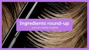 ingredients round up in purple on a background of dark hair being combed